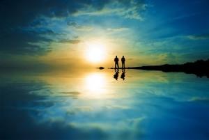 men on beach sunset